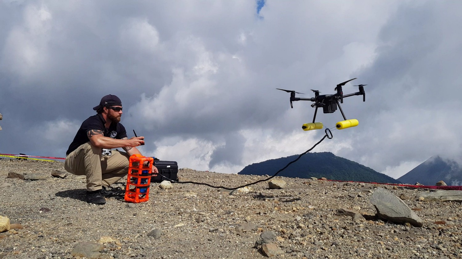 Expert on mission Clayton Covel readies a drone to collect a water sample from the crater of Santa Ana. Photo: WFP/Katarzyna Chojnacka