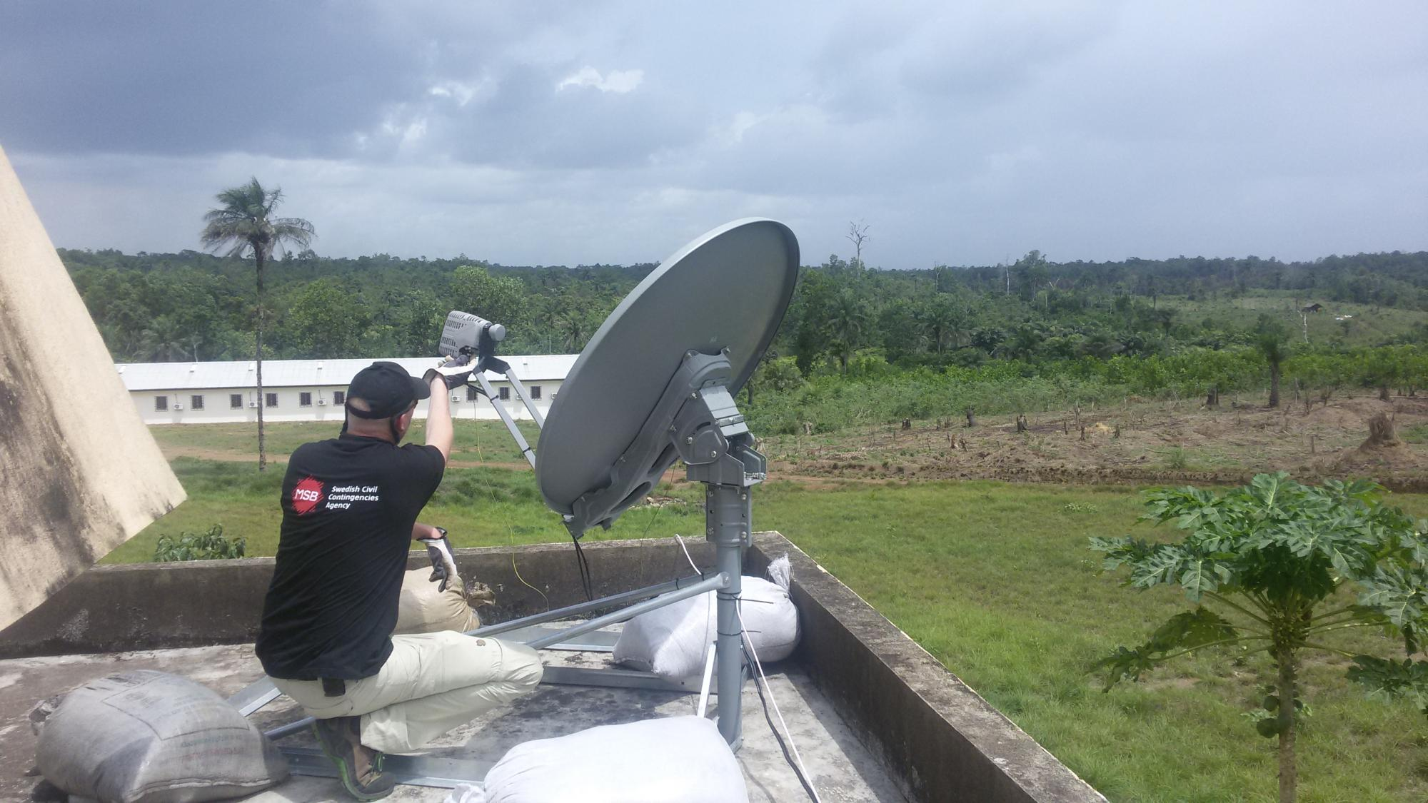 Responders from ET Cluster member Swedish Civil Contingencies Agency (MSB) installing a VSAT at Sinje University of Liberia.