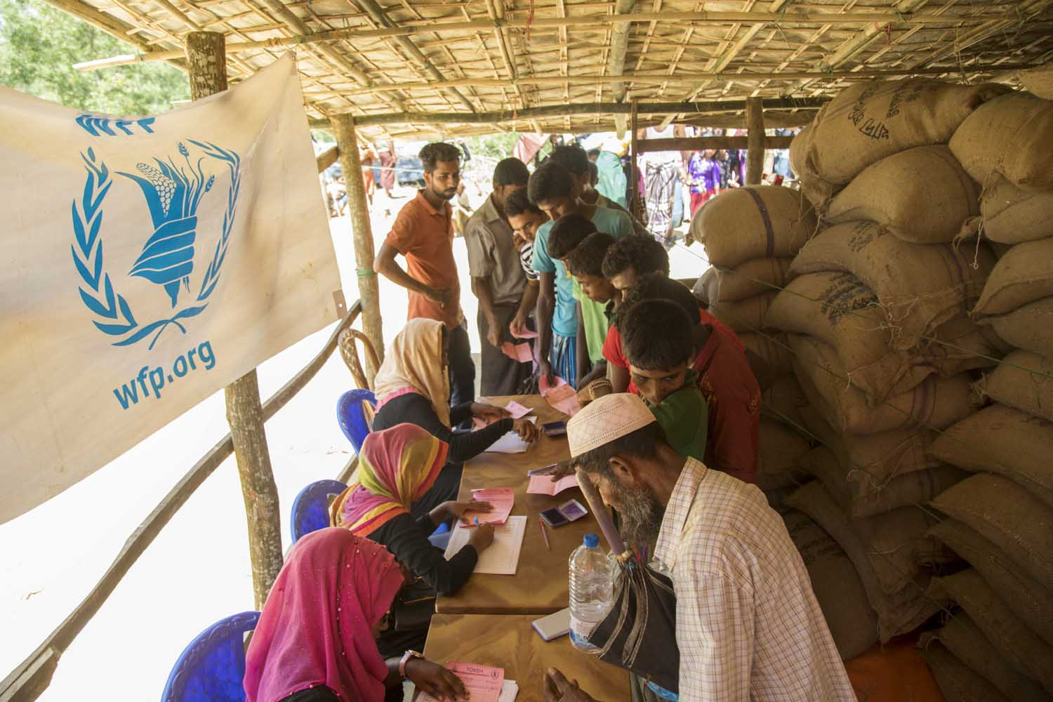 Refugees receiving general food distributions of rice in Cox's Bazar, Bangladesh. Photo: WFP / Saikat Mojumde