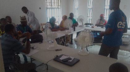 ETS team member training humanitarians in Dikwa on standard telecommunications procedures to carry out their activities safely.