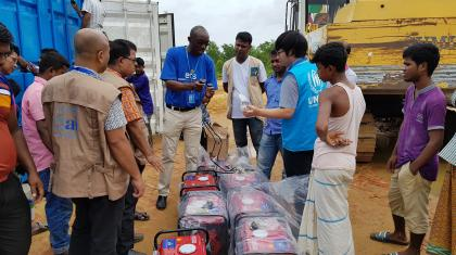The ETS hands over power solutions to UNHCR and Radio Naf for their information hubs