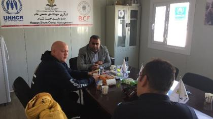 The ETC team meeting with the manager of the Hassam Sham camp in Mosul to better understand the ICT needs of the humanitarian and affected communities.