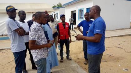 The ETS team informing humanitarians in Damasak about the ETS communications services deployed at the hub and ETS activities available to the humanitarian community in North-East Nigeria.