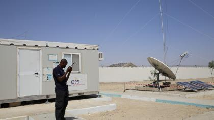 ETS IT specialist conducting maintenance works on the ETS communications services at the humanitarian hub in Ngala