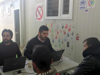 Syrians being registered before taking the online entry exam.